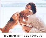 tender home scene with woman... | Shutterstock . vector #1134349373