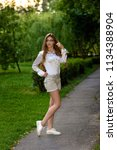 pretty beautiful long legged... | Shutterstock . vector #1134388904