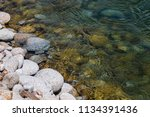 the stone edge of the river | Shutterstock . vector #1134391436