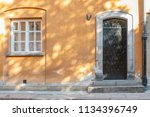 the door and the window in old... | Shutterstock . vector #1134396749