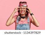 studio shot of desperate young... | Shutterstock . vector #1134397829