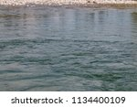 the river with the stone edge | Shutterstock . vector #1134400109