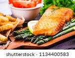fried salmon with french fries... | Shutterstock . vector #1134400583
