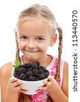 Yummy blackberries - happy healthy girl holding fresh fruits, isolated - stock photo