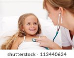 Little girl in bed having a health check - pediatrician listening with stethoscope - stock photo