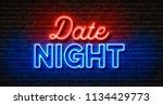 neon sign on a brick wall  ...   Shutterstock . vector #1134429773