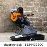 street musician  barcelona   ... | Shutterstock . vector #1134431300