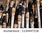 oil drill pipe. rusty drill... | Shutterstock . vector #1134447218
