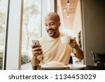 happy cheerful african hipster... | Shutterstock . vector #1134453029