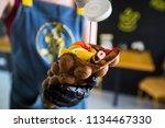 cook prepares hong kong waffles ... | Shutterstock . vector #1134467330
