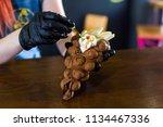 cook prepares hong kong waffles ... | Shutterstock . vector #1134467336