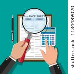 accountant with report ... | Shutterstock . vector #1134489020