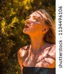 beautiful blonde girl looking... | Shutterstock . vector #1134496106