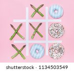 tik tak toe game with donuts... | Shutterstock . vector #1134503549