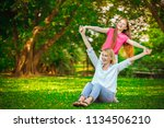 mother and  daughter playing... | Shutterstock . vector #1134506210