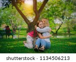 mother and  daughter playing... | Shutterstock . vector #1134506213
