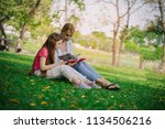 mother and daughter reading a... | Shutterstock . vector #1134506216