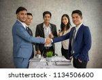 business people shaking hands ... | Shutterstock . vector #1134506600