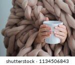 women's hands in a warm soft...   Shutterstock . vector #1134506843