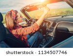 woman drive cabriolet | Shutterstock . vector #1134507746