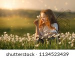 cute curly baby dreaming on... | Shutterstock . vector #1134523439