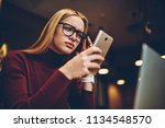 puzzled woman in spectacles for ... | Shutterstock . vector #1134548570
