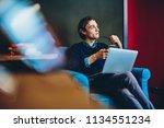 pensive male blogger dreaming... | Shutterstock . vector #1134551234