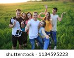 a group of joyful youth on the...   Shutterstock . vector #1134595223