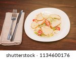 caesar salad with chicken and... | Shutterstock . vector #1134600176