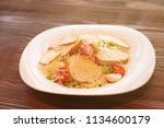 caesar salad with chicken and... | Shutterstock . vector #1134600179