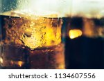 background of cola with ice and ... | Shutterstock . vector #1134607556