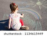 little girl draws a rainbow... | Shutterstock . vector #1134615449