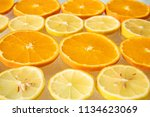 background of sliced oranges... | Shutterstock . vector #1134623069