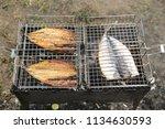 mackerel on a brazier | Shutterstock . vector #1134630593