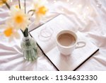 cup of cofee staying on open... | Shutterstock . vector #1134632330