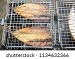 mackerel on a brazier | Shutterstock . vector #1134632366