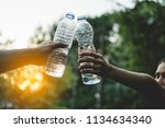 cheers. healthy couple cheering ... | Shutterstock . vector #1134634340