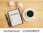 2019 goals text on notepad with ... | Shutterstock . vector #1134638819