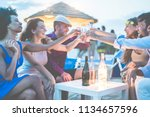 group of young tourist friends... | Shutterstock . vector #1134657596