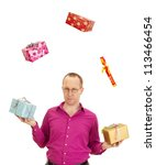 A business person juggling with some colorful gifts - stock photo