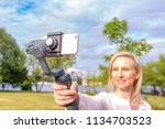 the girl with the phone on the... | Shutterstock . vector #1134703523