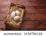 three big fresh goose eggs in a ... | Shutterstock . vector #1134706118