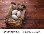 three big fresh goose eggs in a ... | Shutterstock . vector #1134706124