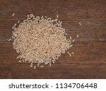 long grain brown rice on rustic ... | Shutterstock . vector #1134706448