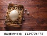 big ostrich egg on straw... | Shutterstock . vector #1134706478