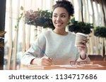 young african descent woman... | Shutterstock . vector #1134717686