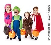 Stock photo halloween trick or treaters in their costumes 113473009