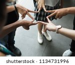 group of teenagers join victory ... | Shutterstock . vector #1134731996