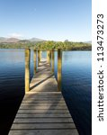 Wooden Piers On Edge Of...