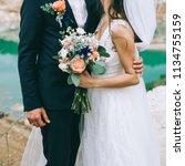 loving couple holding hands... | Shutterstock . vector #1134755159